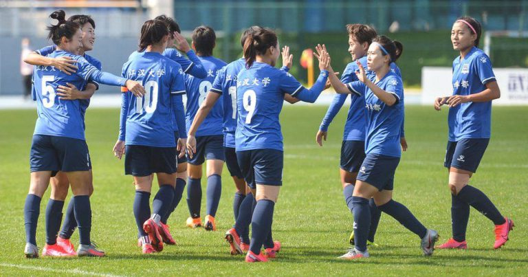 "A women's university football match is called off after one player's hair is deemed ""not black enough"""